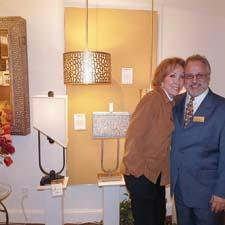 Designer Carolyn Kinder launched her first licensed collection with Quoizel, which held a meet and greet for the designer during market. Here she is with Todd Phillips, co-owner of Quoizel.