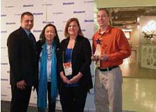 Bulbrite presented its sales and customer awards at market during a reception that included an artisan beer tasting. The customer of the year award was given to Oklahoma-based Hunzicker Brothers. Here, from left, are Bulbrite's Alton McKey and Cathy Choi with Hunzicker's Stacey Loud and Jon Bartel.