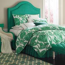 Inspired by a vintage dress found at Massachusetts' Brimfield Antique Show, Company C's new Gretchen bedding uses shades of julep and emerald in an overscaled brushstroke design. companyc.com