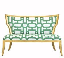 The Garbo Settee is made of European Beech wood in an antique gold finish. The fabric is the Rumer pattern in emerald. curreyco.com