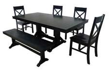 The Millwright Dining Set is finished in black satin solid wood and features distressed edges and tooling marks for a rustic look. walkeredison.com