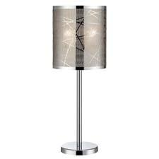 This contemporary table lamp from Lite Source has a chrome metal body and a laser-cut metal shade backed with a lurex liner. lite-source.com