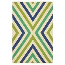 The Chevron flatwoven rug design in Company C's Summer Brights collection is inspired by 1960's pop art and comes in capri blue, shown, and fuchsia. companyc.com