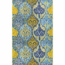 A traditional chandelier-like patterning with delicate details and a cool blue and gold coloration is found in The Rug Market America's Medalla tufted rug, made of wool and viscose. therugmarket.com