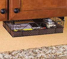 The new Kabinet-Mate, an under-the-counter clutter catcher, is a decorative basket mounted below ball bearing slide rails. ginsey.com