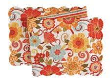 The Giselle table-linens grouping from C&F Enterprises is a floral design in vivid colors. cnfei.com