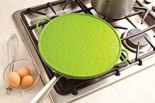 The new silicone splatter guard from Kuhn Rikon can serve as a splatter guard on the stove, a microwave-safe cover, a strainer, and even an oven-safe baking sheet. kuhnrikon.com