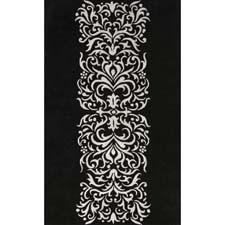 Here in a black and silver colorway, Noble House's Amber collection is handtufted of New Zealand wool and viscose in India. noblehouseinc.com