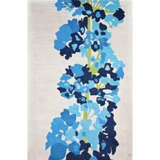 Daphne is a stylized study of a delphinium and comes in two colorways, including blue. emmagardnerdesign.com