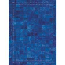 Designer Barclay Butera created Medley in an ink colorway. The over-dyed hide-hair rug includes a double-banded metal stud border and is hand-assembled in India. nourison.com