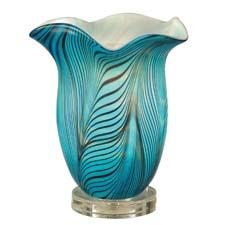 Dale Tiffany has added lighting to its Favrile art glass collection to create tabletop torchieres, a new direction for the company. daletiffany.com