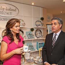 Kathy Ireland and Jim Mylonas of Gorham review Ireland's new tabletop collection in the Gorham showroom.