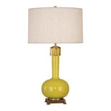 The Athena table lamp from Robert Abbey is a citron-glazed ceramic item with aged brass accents and an open-weave heather linen shade. robertabbey.com