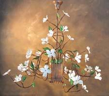 This handcrafted White Dogwood chandelier from Garland Originals is available in rustic copper or white enamel on copper. It can be customized by size, color, style and flower as well. garlandoriginals.com