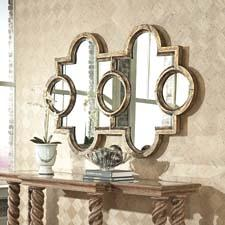 The dramatic Voranado Mirror from Ambella is shown with the company's new hand-brushed burnished gold leaf finish. It can be hung vertically or horizontally. ambellahome.com