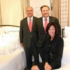 The company's signature introduction during the market was its licensed line of bedding under the Bel-Air brand. From left, Hornick's Louis and Tripp Hornick, and Paulette DuBey of the Bel-Air Association.