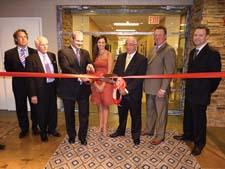 Oriental Weavers opened its new, larger New York showroom at 295 Fifth Ave. Cutting the ribbon were, from left, Andy Brumlow, Oriental Weavers; Jack Michaelson, dc2 Design Consortium; Mike Riley, Oriental Weavers; Mandi Williams, Oriental Weavers; Lou Lombardi, 295 Fifth Ave.; John Brandt, Protec Construction; and Jonathan Witt, Oriental Weavers.