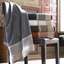 The Savile towel collection is a solid-color set designed with a herringbone pattern on the trim. kassatex.com