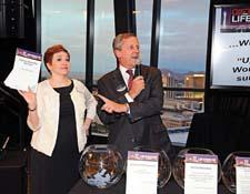 Margaret Powers of IMC and John Keiser of One Coast announce the prize winners.