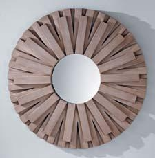 Lighting company Feiss' new mirror category includes Discus, inspired by the traditional sunburst design associated with Louis XIV of France. It has a layered wood design. feiss.com