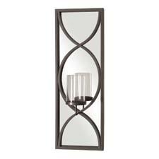 This item from Howard Elliott merges a mirror and an accent piece for a stylish look. It features a metal frame over a mirror with a candle holder. howardelliott.com