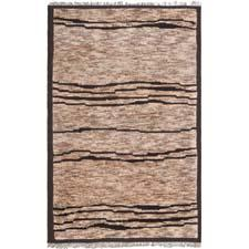 Safavieh's new Tangier collection of Moroccan-weave rugs includes the design TGR644A here. The handknotted collection is made of a blend of wool and hemp in India, and is in natural tones. safavieh.com