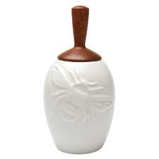 The stoneware Bee Honey Pot has an integrated wood honey dipper underneath its lid. beehivekitchenware.com