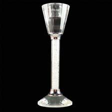 The crystal design candle holder contains hundreds of glass crystals inside the stem for added shine. artistique5.com
