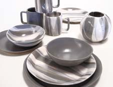 Alex Marshall Studios introduces a new gray and gray-and-white glaze in its slim dinnerware collection. alexmarshallstudios.com
