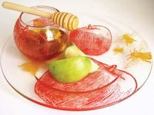 The apples and honey serving set from Barbara Shaw Gifts offers an updated design approach to Rosh Hashanah serveware. barbarashawgifts.com
