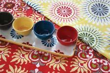The Del Sol collection from tag offers colorful textiles and tabletop with a bright Southwest feeling. tagltd.com