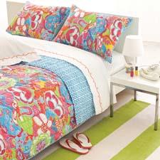 The Twiggy quilt's psychedelic floral print is inspired by the bold and bright looks from the 1960s. pineconehill.com