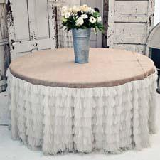 The Chichi tablecloth includes petals individually sewn on the skirt. couturedreamswholesale.com
