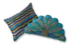 The company's new Cuddledown decorative-pillow collection includes one in a peacock shape and one designed with a chain-stitch wave effect. royalrivertrading.com