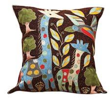 Giraffe is one of a collection of hand-embroidered decorative pillows from South African artist Simon Mahlo. jacarandaliving.com