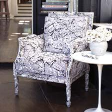 The Spatter Paint Armchair from Tozai Home, a division of Two's Company, offers an edgier look on a traditional shape. tozaihome.com
