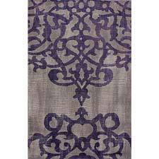 In Nuloom's Remade collection, this area rug is handknotted in wool and then sheared to give it a worn and vintage look. It is available in five sizes. nuloom.com