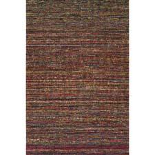 A Harounian exclusive, the Mardi Gras collection has a heavily textured look that blends handwoven multicolored sari silk. The flatwoven rugs are backed for stabilization of the special weaving process. hrirugs.com