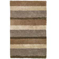 Skyline Shag delivers style in three color-coordinated stripes. Handtufted in India, Skyline is made of 100 percent polyester. The collection is available in gray multi, brown multi and here, sand multi. capelrugs.com