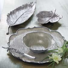 Delicate layers of bronze or silver add opalescent luster to woven grass cloth in nature-inspired shapes. mariposa-gift.com
