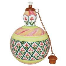 The handpainted Shabby Shiek collection of garden torches is made by Mexican artisans. lacandela.co