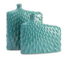 Inspired by peacock feathers and enhanced with a turquoise finish, Ling vases have a transitional feel and add asymmetrical elements of color to any decor. imaxcorp.com