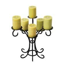 The black powder-coated Sprig Candelabra stands out with its curved stems and small footprint. achla.com