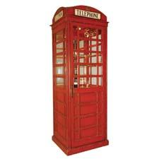The Telephone Booth Bar Cabinet from Maitland Smith is painted antique red with glass panels and retails for $7,800. maitland-smith.com