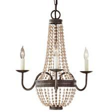 Feiss expands its lower-priced Home Solutions line, which includes the Charlotte mini chandelier, here in ivory with a Peruvian Bronze finish. It evokes a French Market feel. feiss.com
