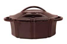 Cast-iron cookware:The newly launched Isaac Mizrahi line from Gibson Overseas includes colored cast iron pieces in unusual shapes, a piece for the M Dot line shown here in mahogany. gibsonusa.com
