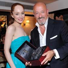 "Lotte Verbeek of HBO's ""The Borgias"" and Domenico Vacca admire the designer's new piece he created with Rogaska."