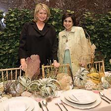 Martha Stewart and Darcy Miller Nussbaum of Martha Stewart Weddings admire one of the lobby tables created by the magazine.