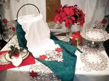 The Vintage collection includes cutwork tablecloth coordinates with round cutwork placemats, napkins and allover cutwork runners. 212-889-6376