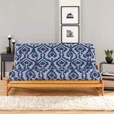 Ikat, a new slipcover design in three colorways, is available as a futon cover and in decorative pillows and floor cushions. surefit.net